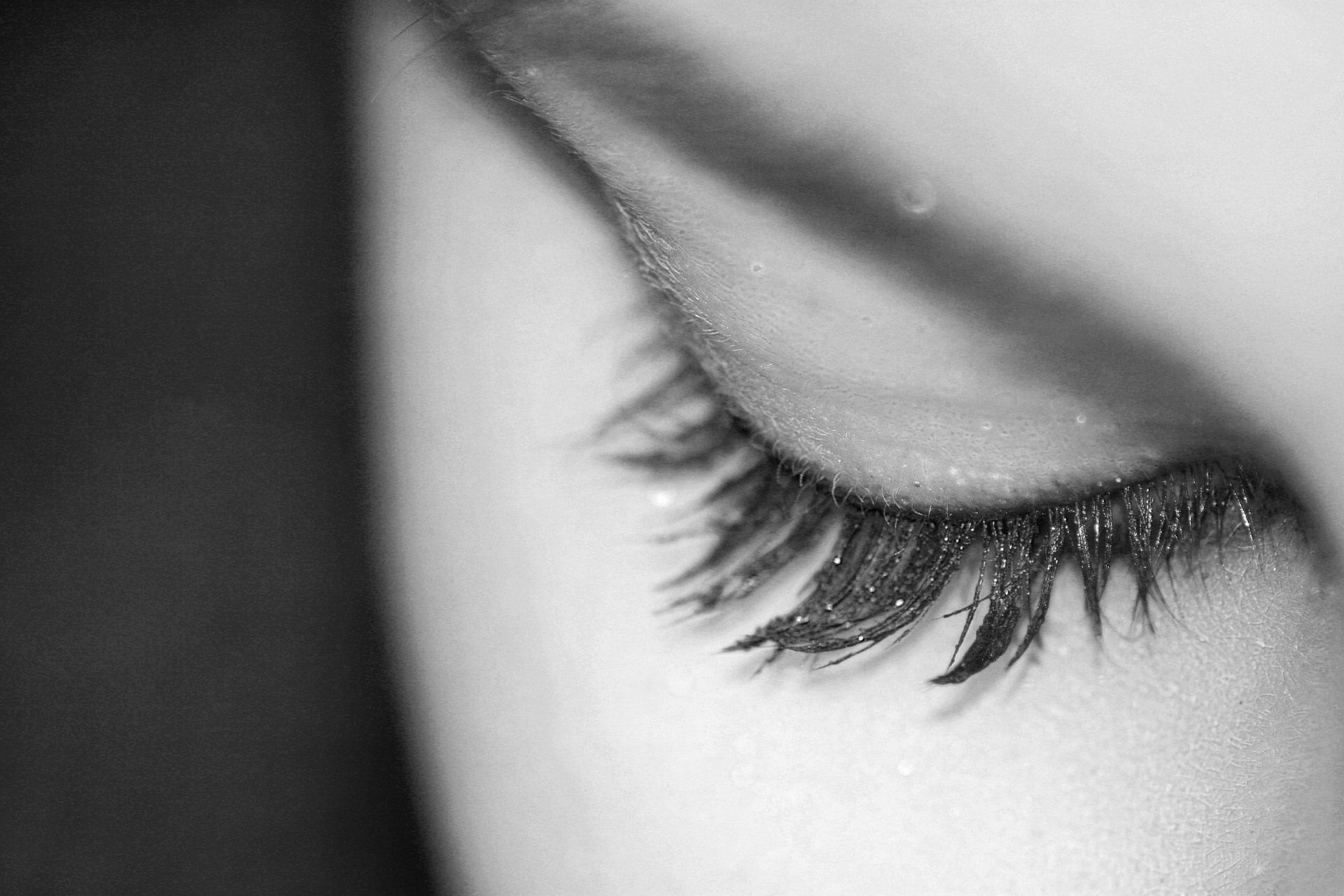 Close up of a woman's closed eye who has had eyelash extensions applied. For use on the Classic Lashes Course page.