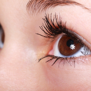 Close up of a woman with brown eyes who has had an eyelash lift. For use on the Lash Lift Course page.