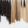 Rows of different coloured long hair extensions. Used for the Online Hair Extensions Course page.